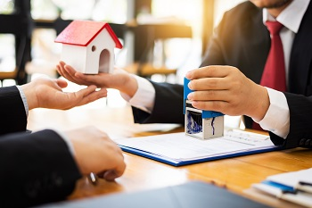 House real estate sell agent reviews the documents that have been approved for the home buyer loan,local movers